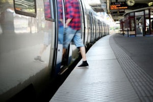 Motion blurred man entering train