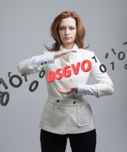 DSGVO, german version of GDPR, concept image. General Data Protection Regulation, protection of personal data. Young woman working with information. Datenschutz-Grundverordnung.